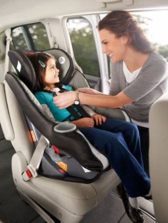 child riding in car seat